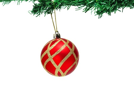 red and golden christmas ball hanging on a christmas tree photo