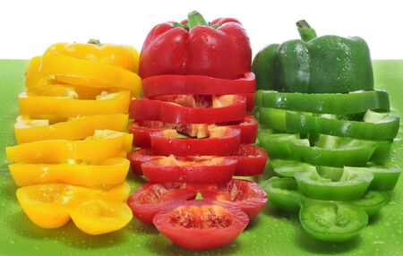 some yellow, red and green peppers sliced Stock Photo - 11325901