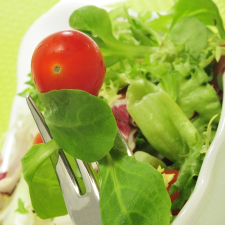 cornsalad: closeup of a plate with salad with cherry tomatoes