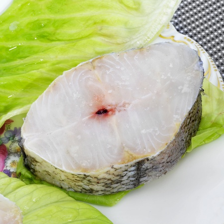 hake: closeup of a raw hake slice in a platter