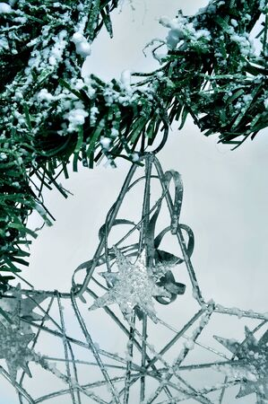 closeup of a christmas star hanging on a branch of a snowy christmas tree Stock Photo - 11326343