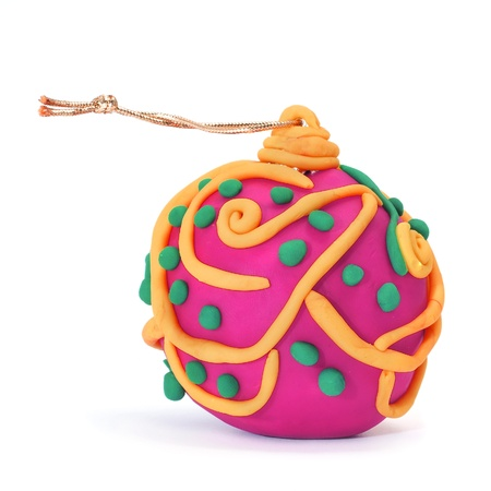 clay craft: a colorful christmas ball made with modelling clay on a white background  Stock Photo