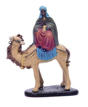 balthasar: figure representing Balthasar Magi riding a camel on a white background