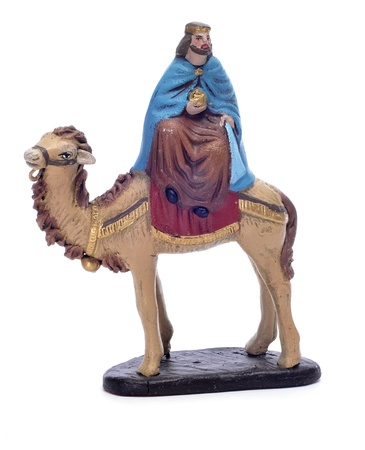 melchior: figure representing Melchior Magi riding a camel on a white background