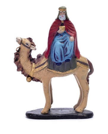 figure representing Caspar Magi riding a camel on a white background photo
