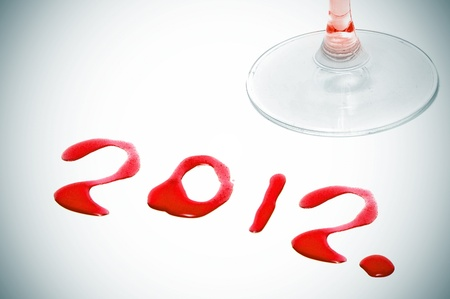 vignetted: 2012 written with red wine on a white background