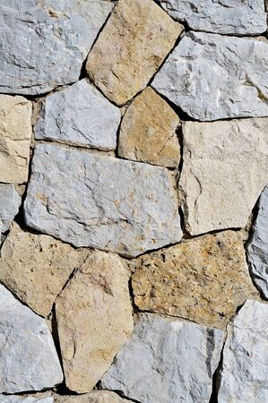 stone work: background made of a close-up of a stone wall
