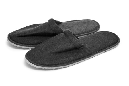 houseshoe: a pair of black slippers on a white background