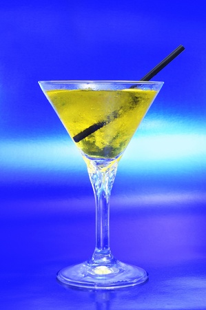 thirstiness: a glass with cocktail on a blue background Stock Photo