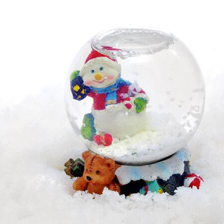 christmas snow globe with a snowman inside it on the snow photo