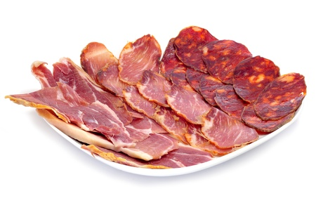 spanish food: a pile of different spanish embutido, jamon, chorizo and lomo embuchado