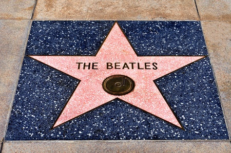 annually: Los Angeles - October 16, 2011: The Beatles star in Hollywood Walk of Fame on October 16, 2011 in Los Angeles. Those more than 2,400 five-pointed stars attracts about 10 million visitors annually Editorial