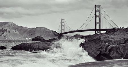 black bridge: A view of Golden Gate Bridge from Baker Beach in San Francisco, United States