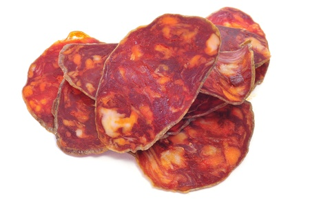 some slices of red spanish chorizo on a white background Stock Photo - 11549639