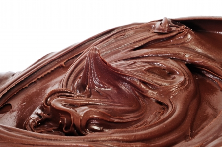 creamy: a pile of chocolate spread on a white background