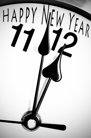 31: closeup of a clock minutes before midnight and sentence happy new year written in it