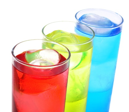 thirstiness: some glasses with cocktails of different colors on a white background