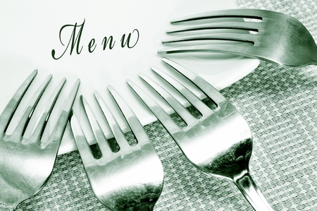 word menu written in a plate with some forks photo