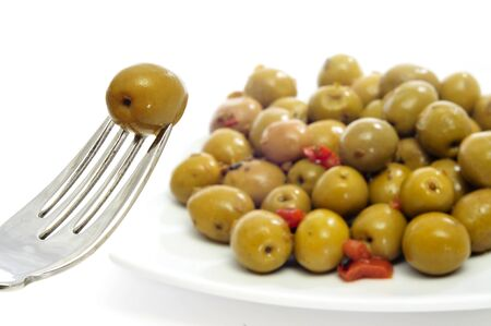 macerated: closeup a plate with olives as a spanish tapa
