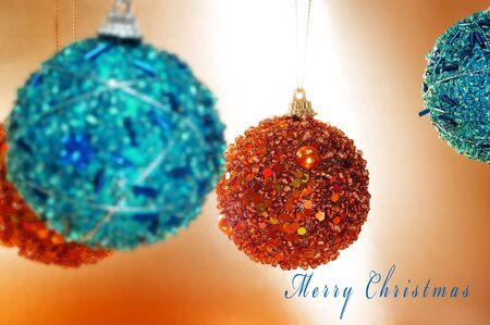 sentence merry christmas and some shiny christmas balls photo
