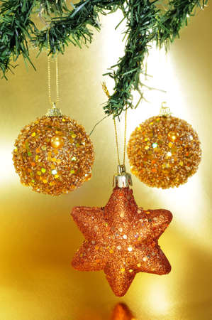 new year eve beads: some shiny christmas ornaments hanging on a christmas tree