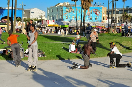 Venice, US - October 16, 2011: Skaters in Venice Beach in Venice, US. A lot of skaters use to perform in the skating rink placed in the Ocean Front Walk