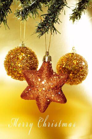 sentence merry christmas and some shiny christmas ornaments hanging on a christmas tree photo