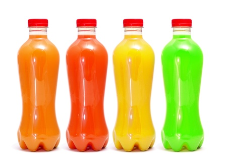 some bottles of different colors with different juices on a white background photo