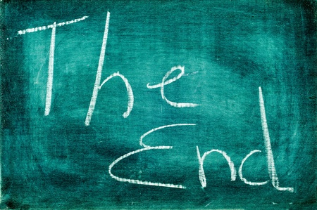 love movies: sentence the end written with chalk on a chalkboard
