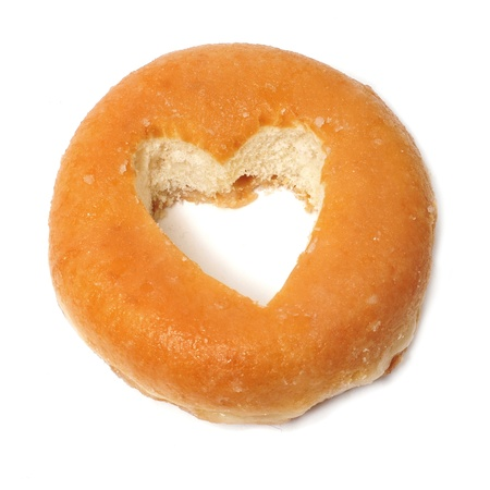 a donut with a heart-shaped hole on a white background photo