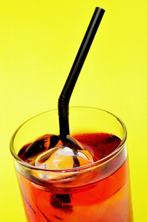 thirstiness: a glass with a red cocktail on a yellow background