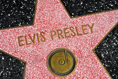 famous industries: Los Angeles - October 16, 2011: Elvis Presley star in Hollywood Walk of Fame in Los Angeles. Those more than 2,400 five-pointed stars attracts about 10 million visitors annually