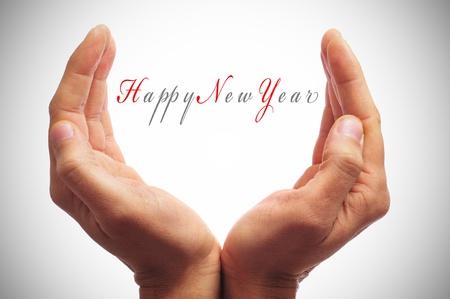 fin de ao: feliz a�o nuevo con las manos formando una copa Foto de archivo
