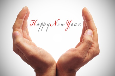 hand written: happy new year with hands forming a cup Stock Photo