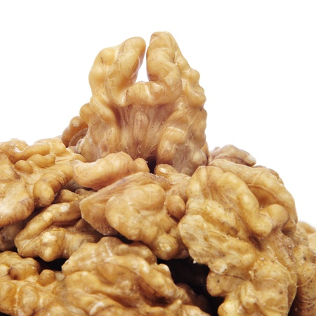 a pile of shelled walnuts on a white background Stock Photo - 11760774