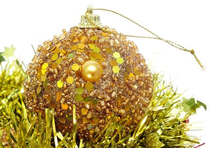 a shiny golden christmas ball and tinsel on a white background photo