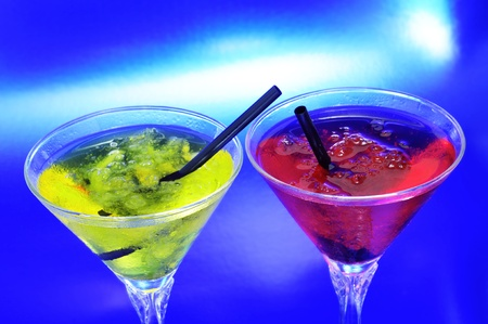 thirstiness: cocktail glasses with different coctkails on a blue background