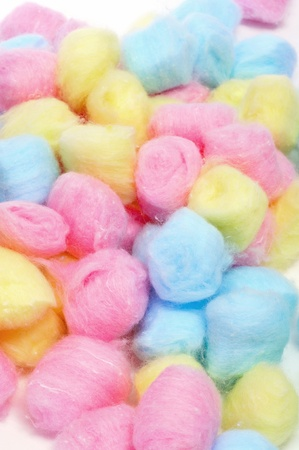 closeup of a pile of cotton balls of different colors photo