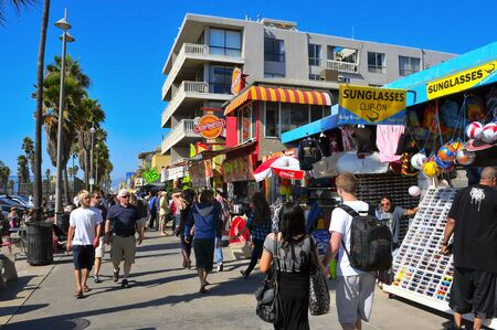 Venice, US - October 16, 2011: Ocean Front Walk of Venice Beach in Venice, US. This boardwalk, 2.5 kilometer long, is full of colorful shops and food stalls