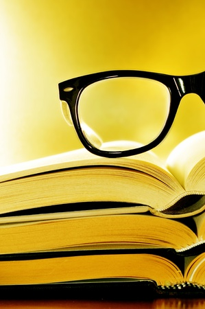 habit: a pile of books and glasses symbolizing the concept of reading habit or studying Stock Photo