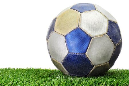 a soccer ball on the grass on a white background photo