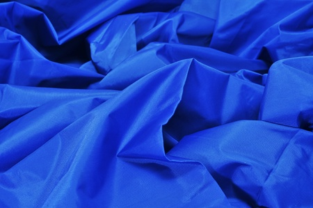 closeup of a blue satin fabric backdrop photo