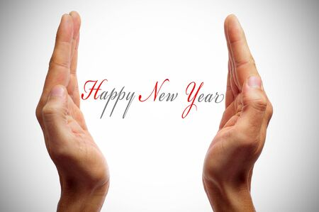 happy new year with open hands as if offering a gift Stock Photo - 11771254