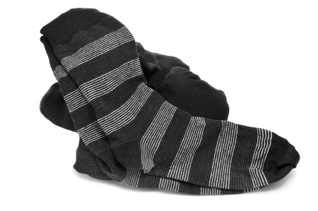 a pair of striped socks and some folded socks on a white background