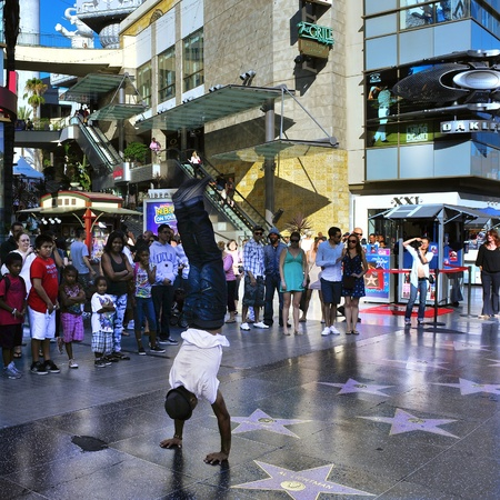 Los Angeles, US - October 16, 2011: Performance in Hollywood Walk of Fame in Hollywood Boulevard in Los Angeles. About 10 million people visit annually this popular area of Hollywood