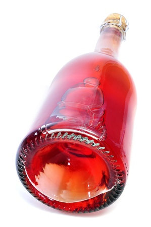 thirstiness: closeup of a red sparkling wine bottle on a white background  Stock Photo