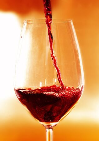 thirstiness: closeup of a glass with red