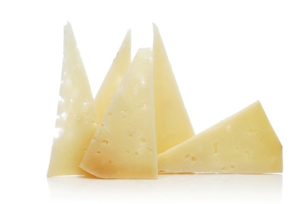 cured: some slices of manchego cheese on a white background