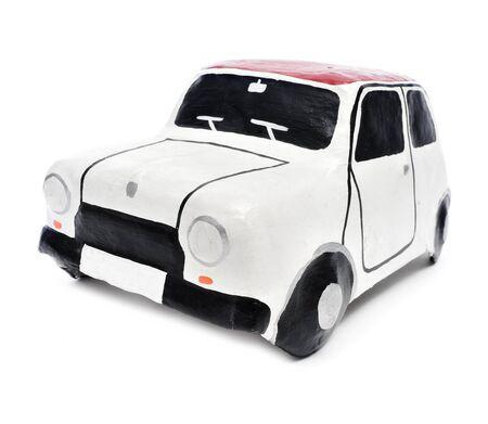 papiermache: papier-mache toy caron a white background