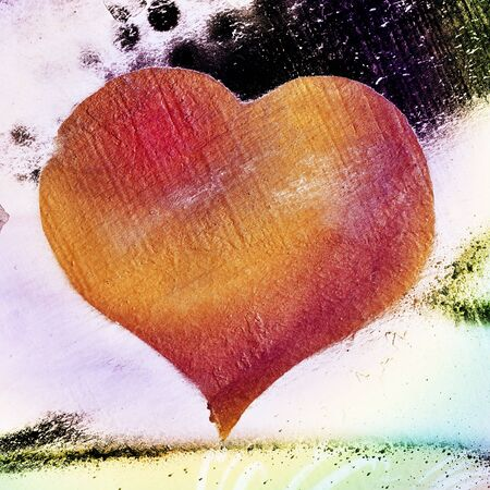 background with a heart as a graffiti in a wall photo